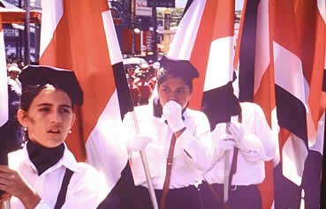 Students carrying Costa Rican flags at Sept. 15th Independence Day celebration